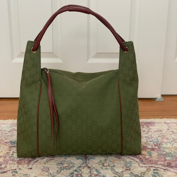 f02b86fc81db52 Gucci Handbags - Gucci green/monogram canvas hobo bag